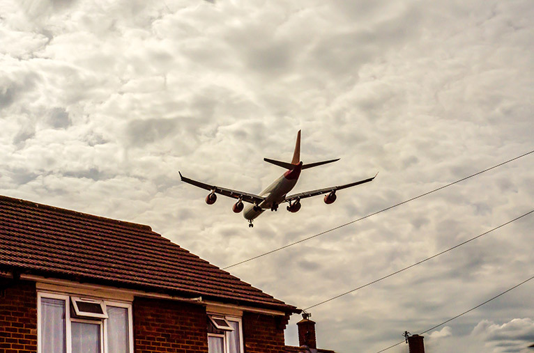 Plane flying over a home