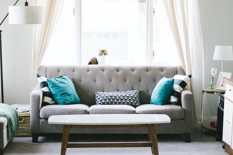 Grey fabric sofa with blue cushions