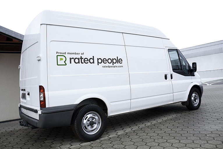 White van with Rated People sticker