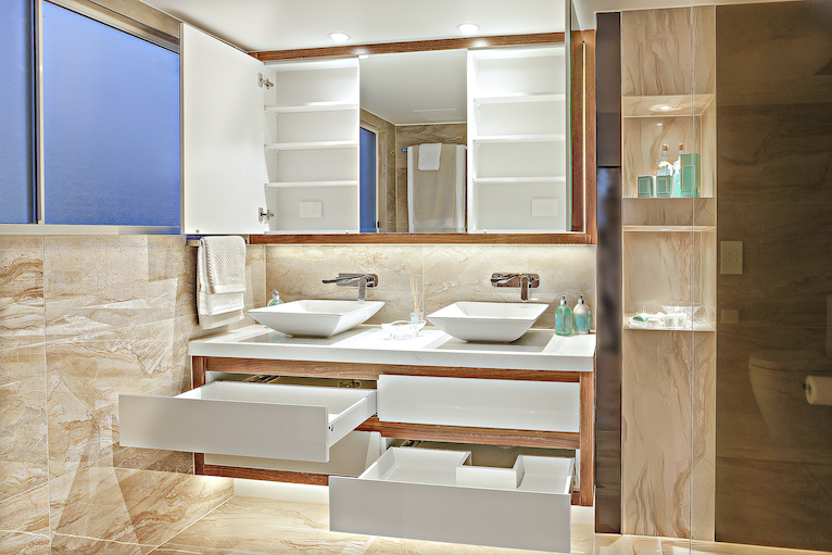 Bright bathroom with open cabinets and drawers
