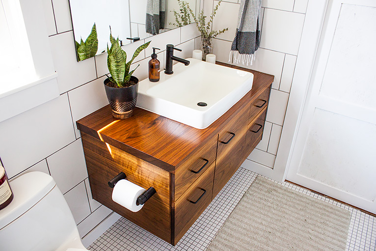 Wooden sink vanity unit with built-in toilet roll holder