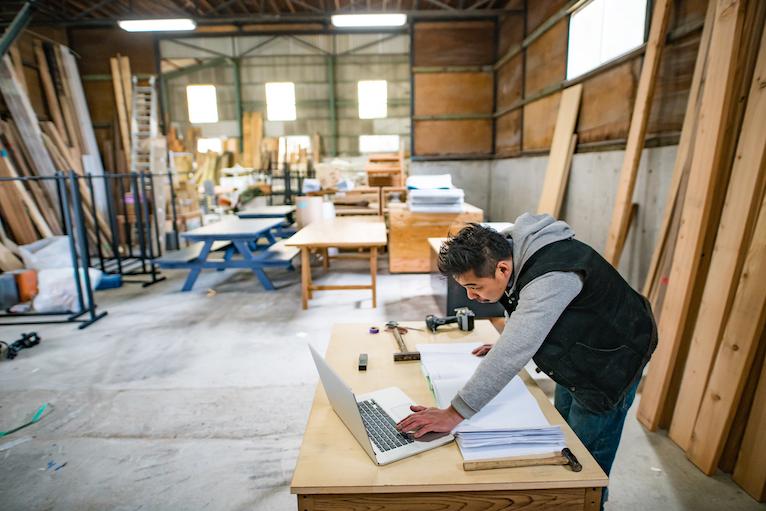 Carpenter looking at laptop