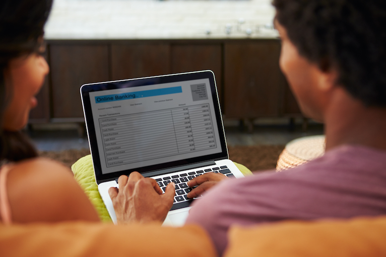 Couple looking at online banking on laptop