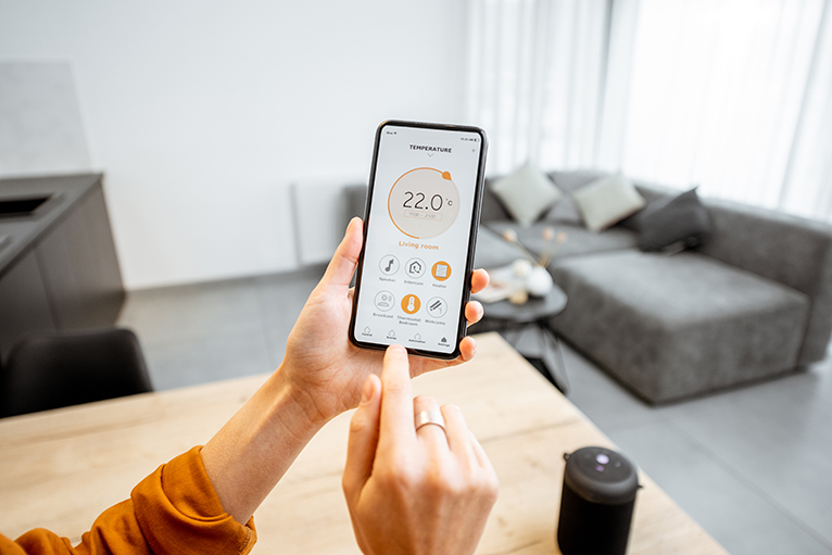 Person adjusting heating schedule on smartphone