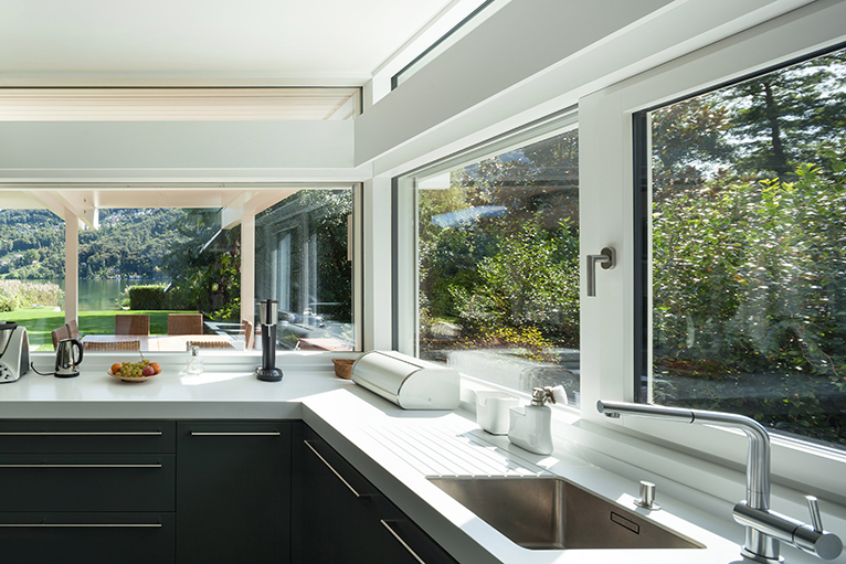 Kitchen with multiple window looking into garden