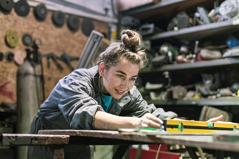 Apprentice working in a workshop