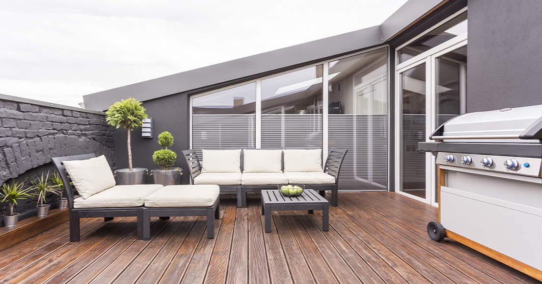 Big outdoor space with wooden decking, garden furniture and BBQ.