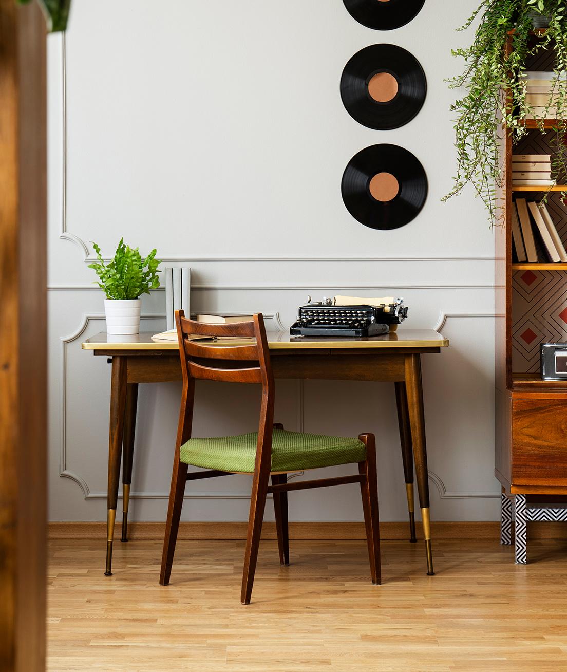 Wooden writing desk with typewriter.