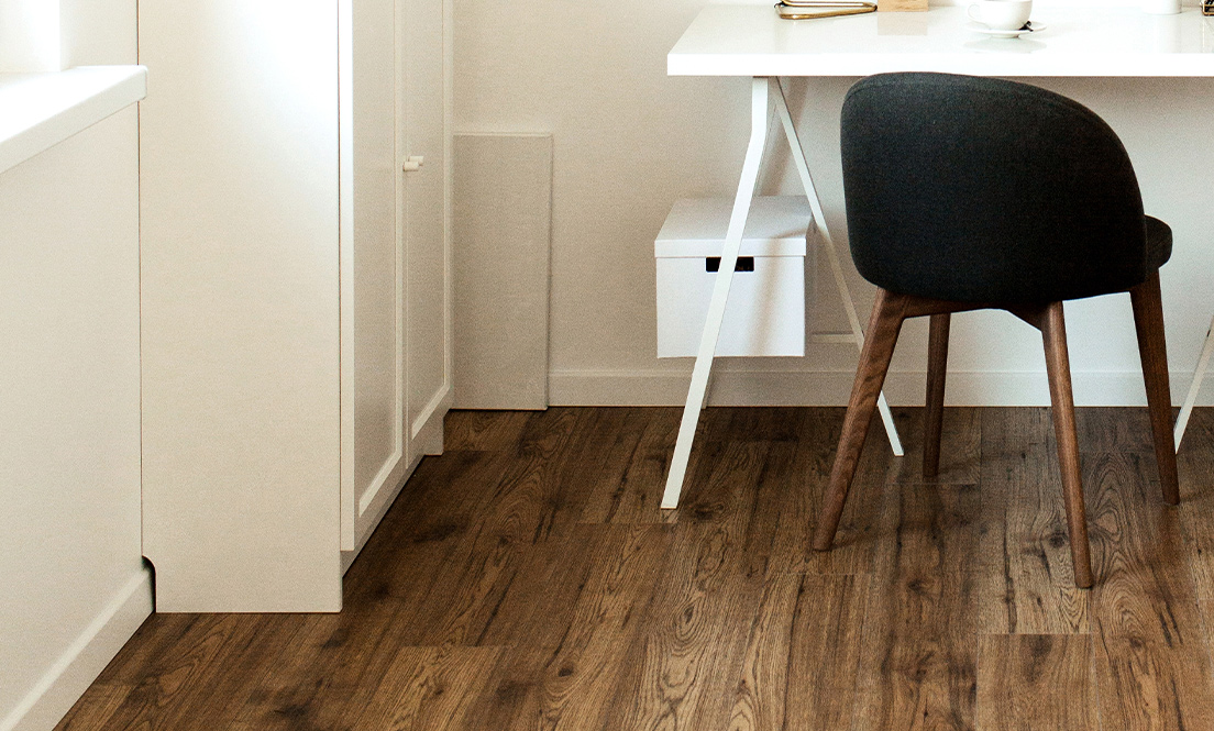 Medium brown wooden floorboards in a home office.