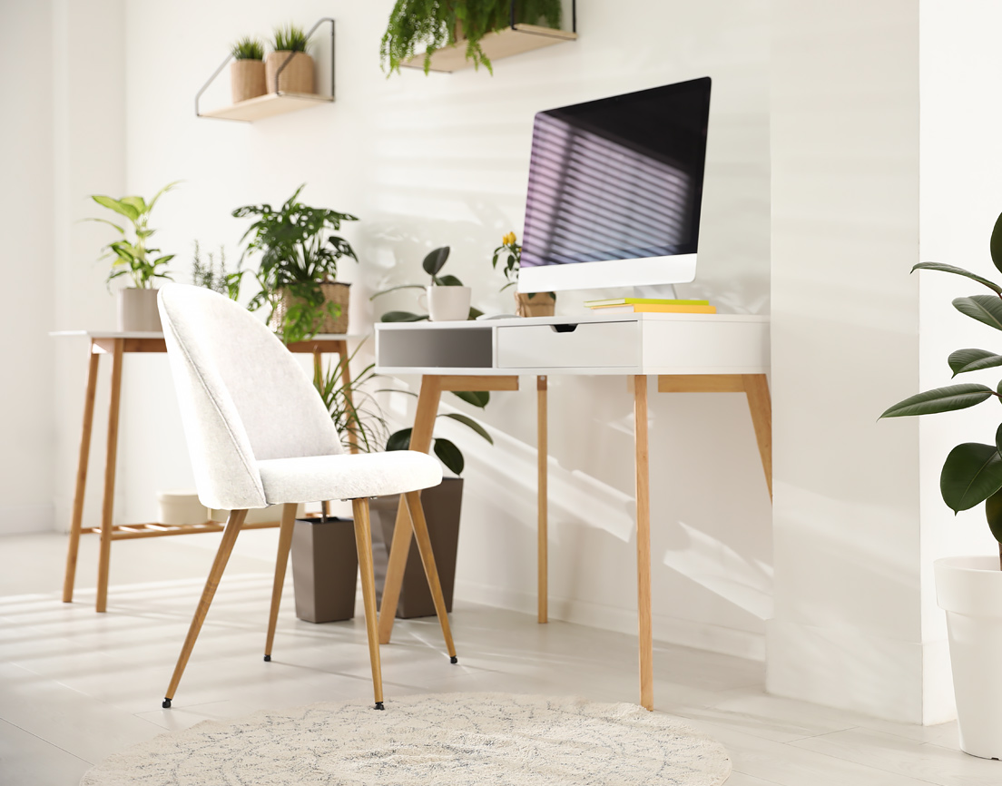 White fabric chair with fixed legs.