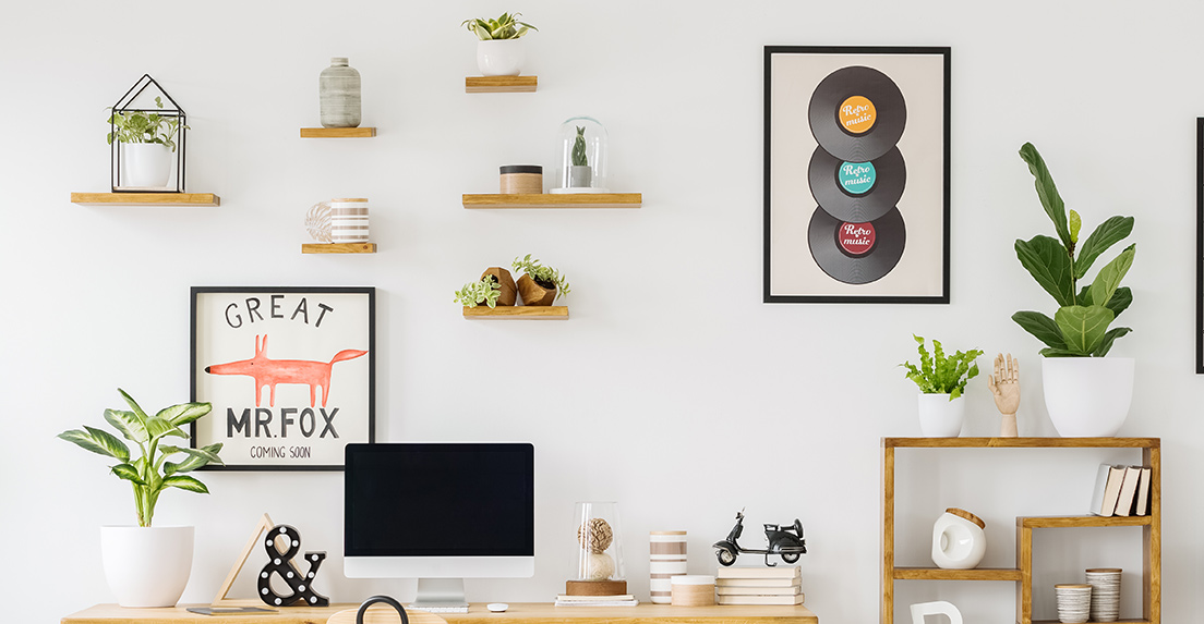 Six simple wooden shelves on the wall in a home office.