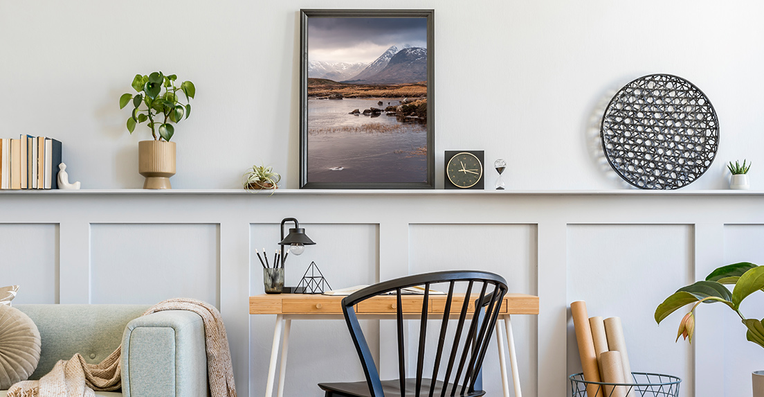 Framed print of the outdoors in a home office.