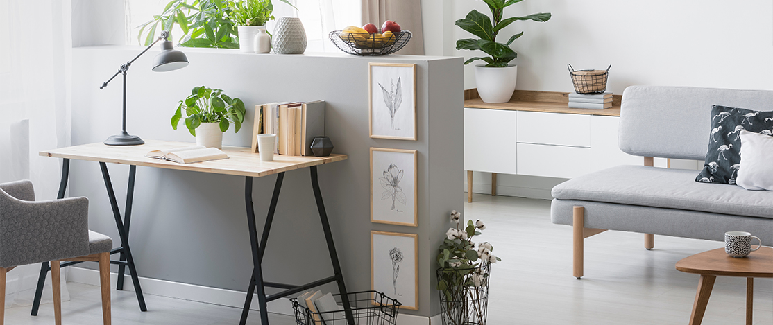 Stylish interior with grey walls and work area.
