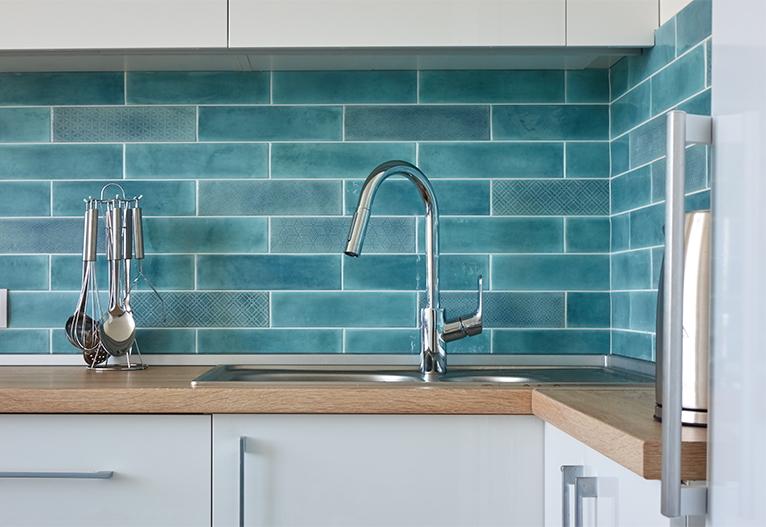 Light blue tiled splashback