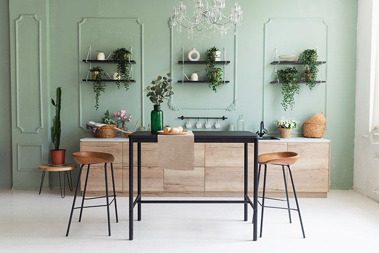 Two tone kitchen with green wall paint and wooden cabinets