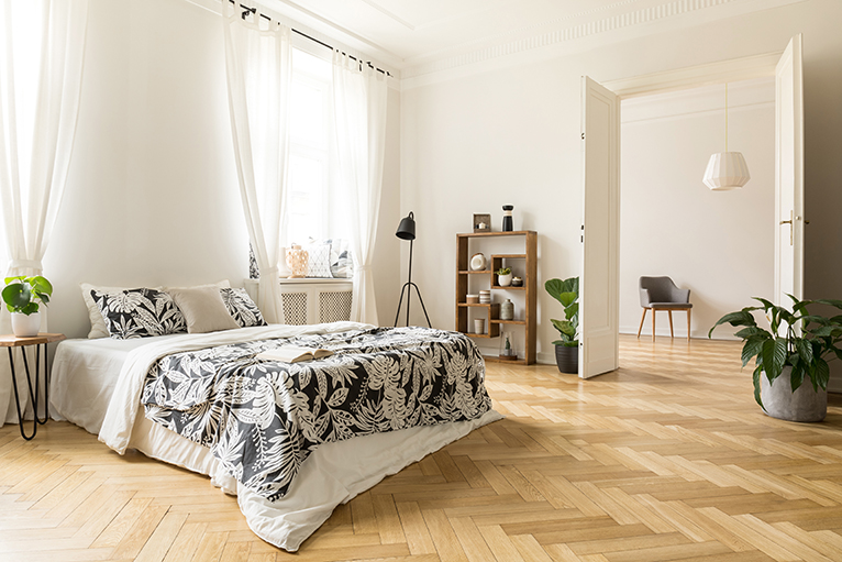 Large bedroom with herringbone floor