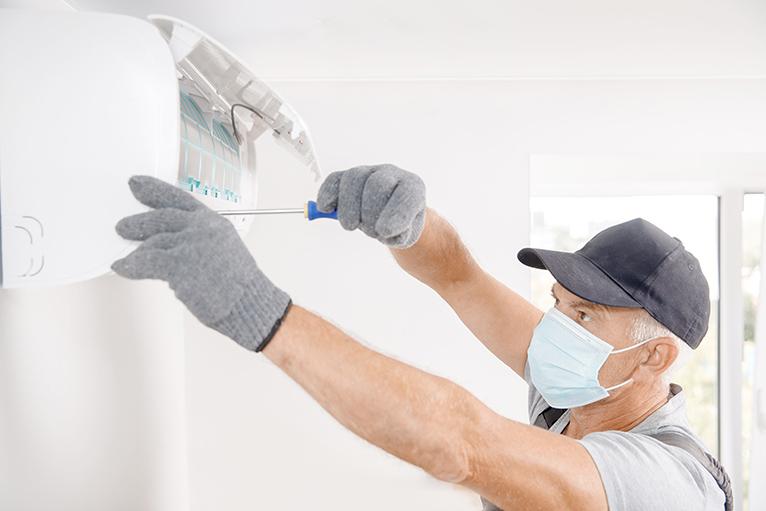 Technician doing a repair in a home