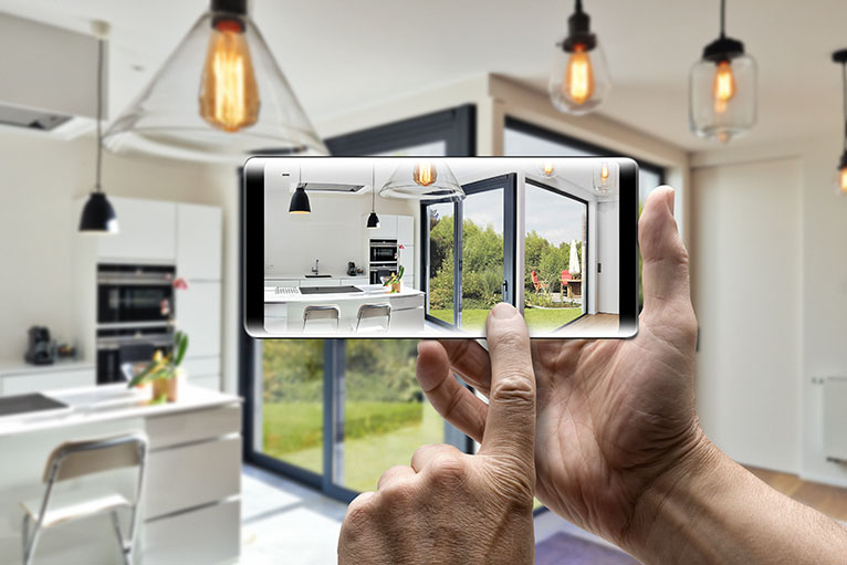 Person taking a photo of kitchen on smartphone