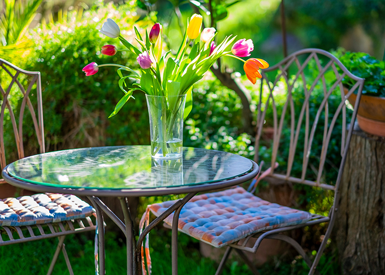 Tulips in vase on outdoor table