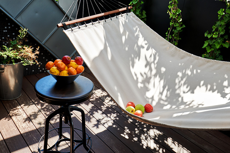 Small patio with hammock