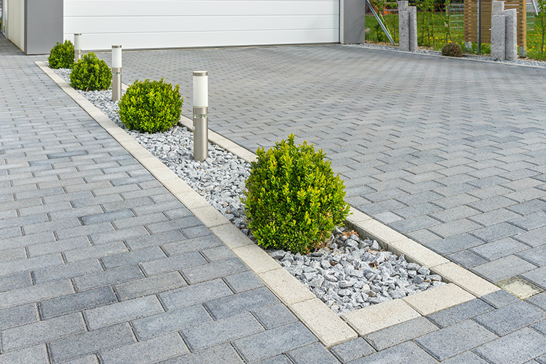 Plants and decorative pebbles in edging