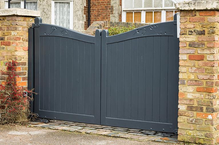 Wooden, dark grey driveway gate