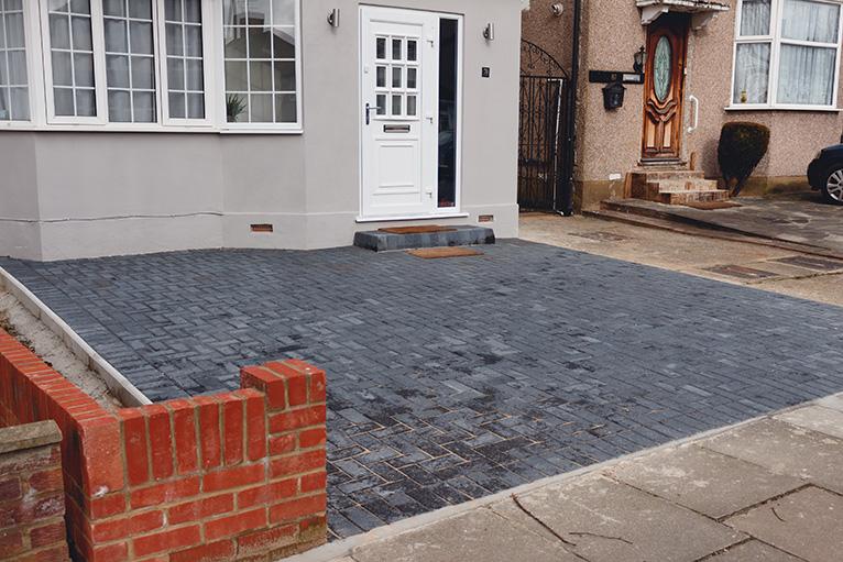 New, dark grey driveway in London, UK