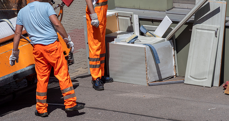 Removal men removing household waste
