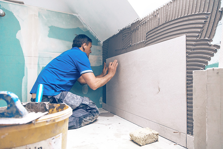 Homeowner demand: Tiler working in a home