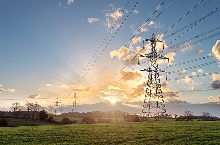 Pylon in sunny field