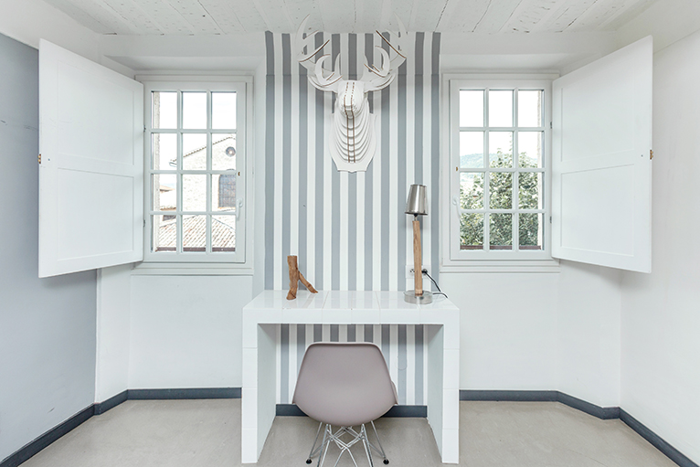 White and grey striped feature wall in home office