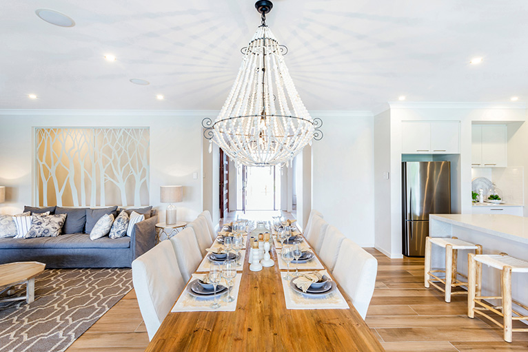 Chandelier hanging above dining table