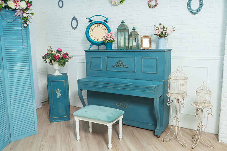 Blue piano in room with blue decor and interior design