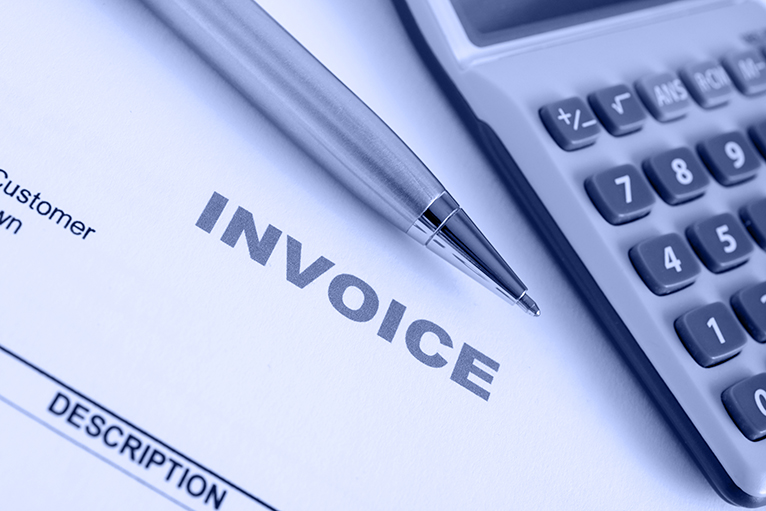 Invoice, pen and calculator