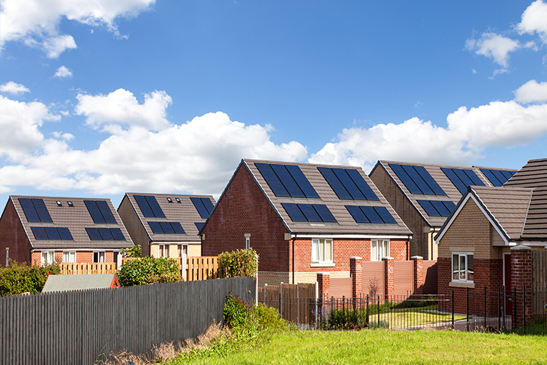 Solar PV panels on rows of homes