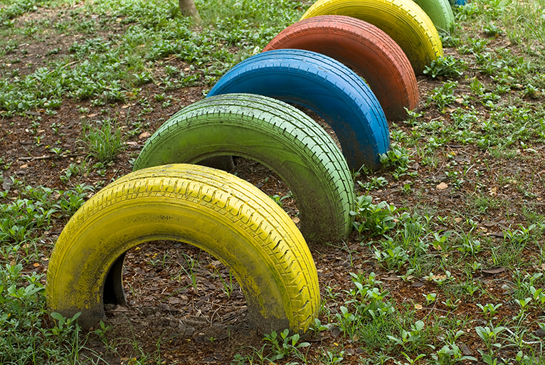 Upcycled tires in garden as children's play equipment