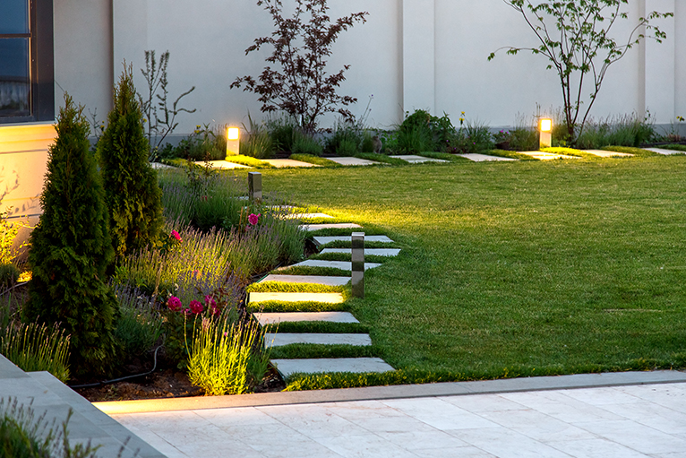 Small all year round garden with post lights