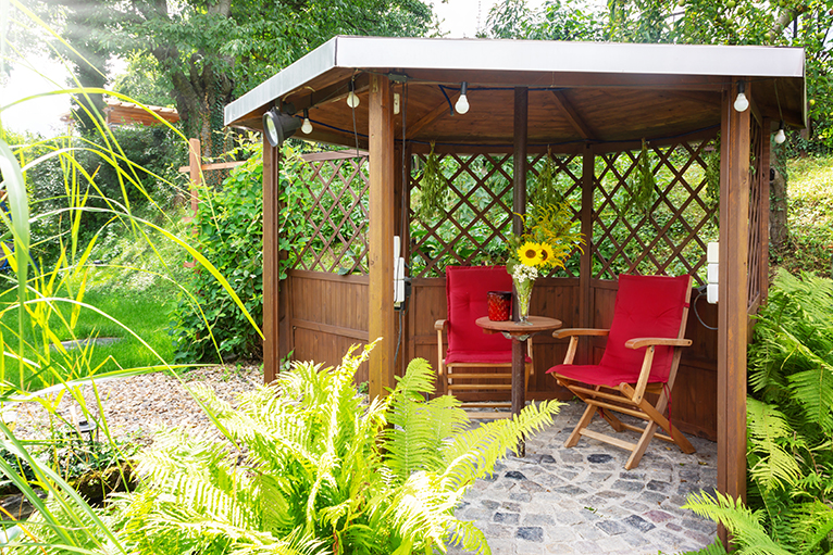 Garden pavilion with pond, sitting area and trellis, in all year round garden