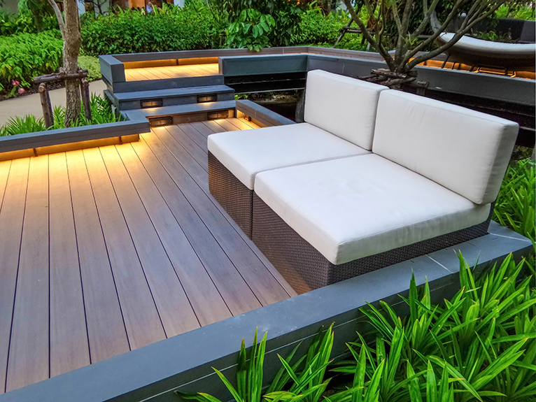 Garden walkway with seating and low lighting, in all year round garden
