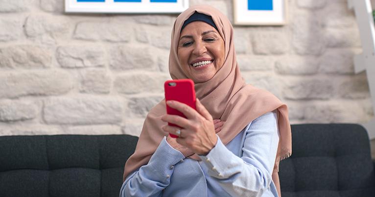 Smiling customer looking at phone