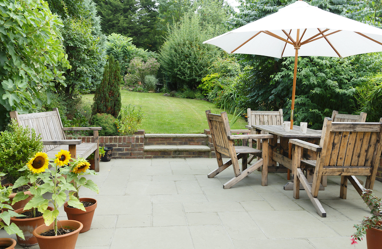 Garden with paved patio and lawn