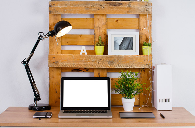 Pallet upcycled into desk storage