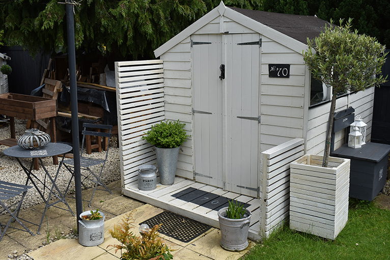 Garden shed with doorstep, used as crafts room