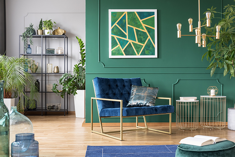 Living room with green interior design and plants