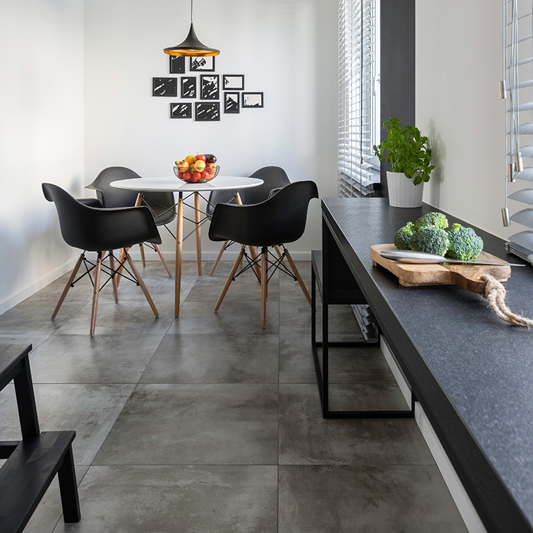 Small kitchen with concrete floor tiles