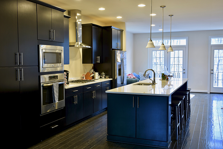 Modern kitchen with dark cabinets and light countertops