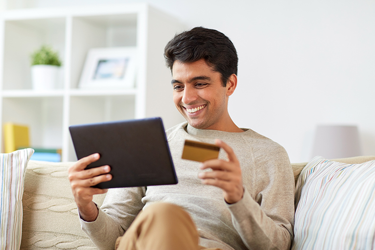 Person using online banking on a tablet