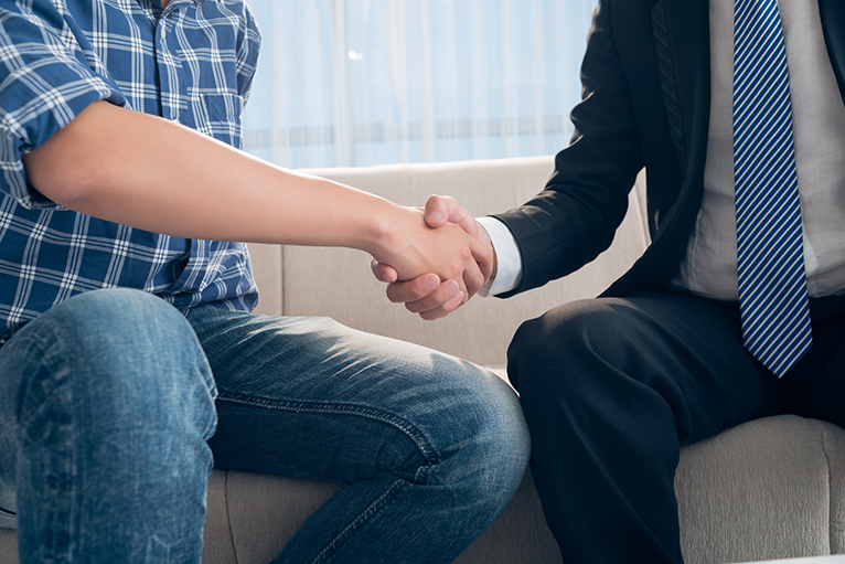 Person shaking hands with financial consultant