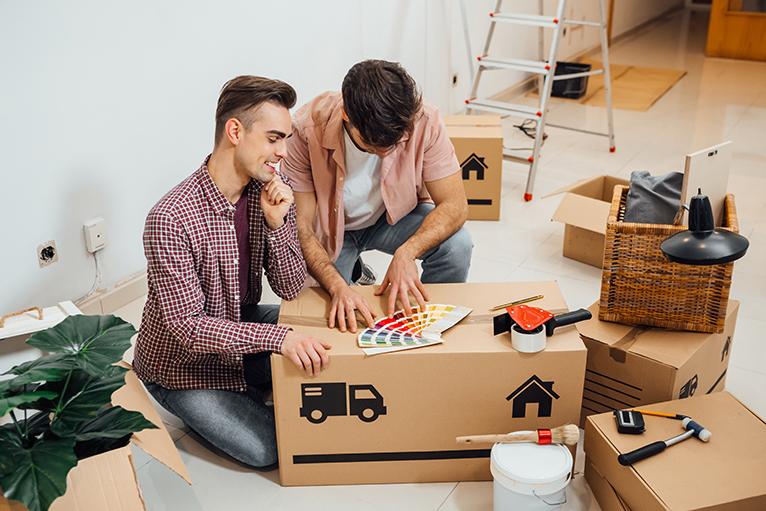 Couple choosing paint colour for home