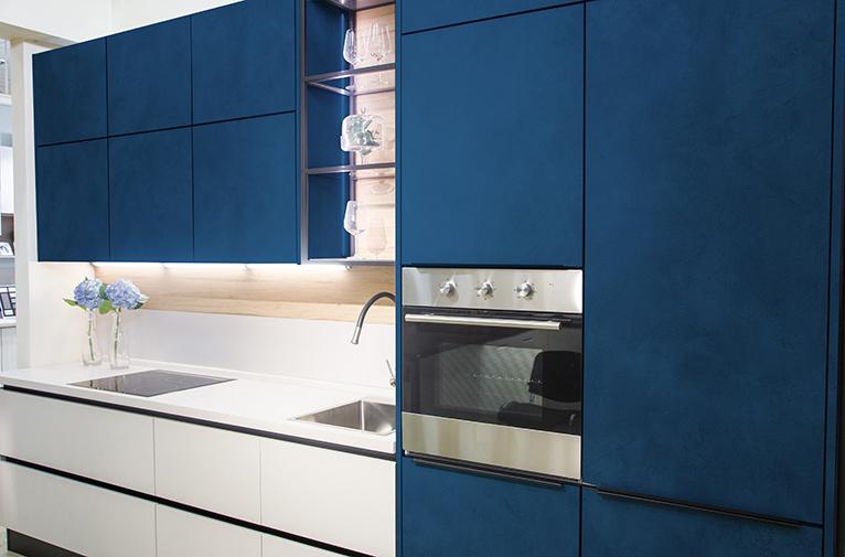 Modern kitchen with dark blue cabinets